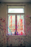Window with color splashes Royalty Free Stock Photo