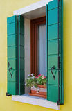 Window in a colorful apartment building in Burano, Venice, Italy. Italy. Window in a colorful apartment building in Burano, Venice Royalty Free Stock Photography