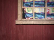 Window With Colorful Curtains. Wooden rustic house window with colorful curtains in a sunny day Royalty Free Stock Photo