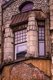 Window with columns in the old house with the broken facade Stock Photos