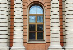 Window with colunms. Window with wooden frame and white columns with stripes Royalty Free Stock Photo