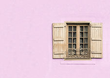 Window with copy space. Shuttered window on pastal pink stucco wall with copy space Stock Photos