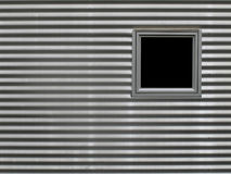 Window in corrugated aluminum wall Stock Image