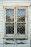 Window in corrugated iron building Stock Image