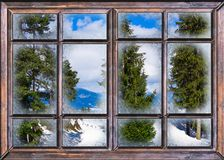The window is covered with ice frost. Winter landscape view from the window is covered with ice frost Stock Photos