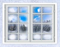 The window is covered with ice frost. Winter landscape view from the window is covered with ice frost Stock Photography