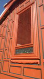 Window crafting on Red painted wooden wall Stock Image