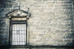 Window on creepy stonewall Stock Photography