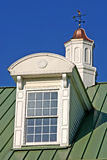 Window and Cupola Detail. Dormer window and cupola with weather vane Royalty Free Stock Image