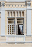 Window with curtain Stock Image