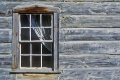 Window with curtain in log building in Ghost Town near Virginia City, MT Royalty Free Stock Photos