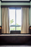 Window, curtain and seat Royalty Free Stock Image