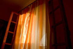 Window Curtains. Open window in dark room and curtains Stock Photos