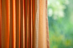 Window curtains. Open window curtains with green tree background Royalty Free Stock Image