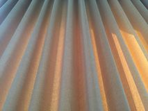 Window curtains. With background sunlight Stock Photos