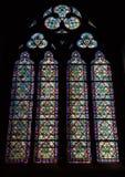 Window in dark interior of the Notre Dame de Paris Stock Image