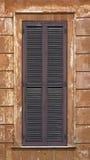 Window with dark magenta shutters Stock Image