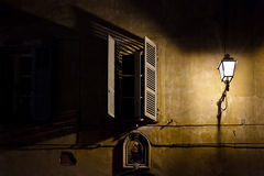A window in the dark near a light pole Royalty Free Stock Photography