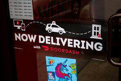 DoorDash and Wendy`s delivery sign royalty free stock photos