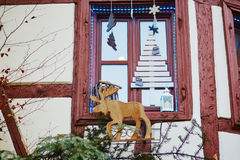Window decorated for Christmas in French or German town Royalty Free Stock Photos