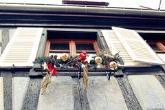 Christmas window ornaments in a small village Alsace. A window decorated for Christmas in a small village in Alsace, France Royalty Free Stock Photography