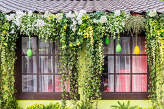 Window decorated with colorful flowers and plants for Easter Royalty Free Stock Images