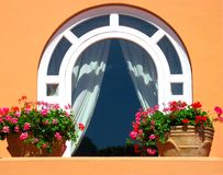 Window decorated with flowers Royalty Free Stock Photos