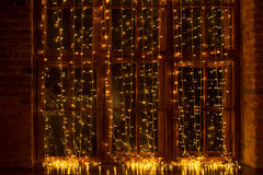 A window decorated with a garland Royalty Free Stock Photography