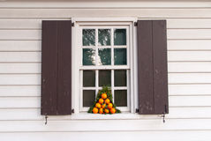 Window decorated with oranges for the holidays. Royalty Free Stock Images