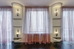 Window decoration curtains. Elegant design of window curtains and blinds Royalty Free Stock Image