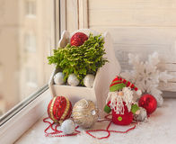Window decoration for the winter holidays with a toy and Selagin Stock Image