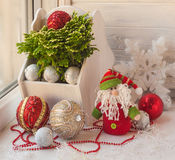 Window decoration for the winter holidays with a toy and Selagin Stock Photo