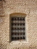 A window with a decorative bars in a brick wall Royalty Free Stock Image