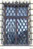 Window with decorative metal grid Stock Photo