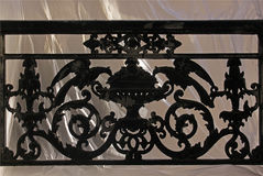 Window with decorative railing from black smithery iron. On a neutral background. 13-15 rue Croissant, Paris, France. August 31, 2017 Stock Photos
