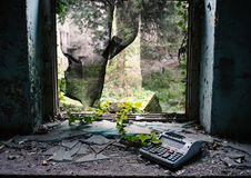 Window destroyed in abandoned building with ivy and a broken cash register stock photos
