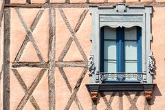 Window detail of medieval house in Toulouse, France. Ornate window in half-timbered house, with wrought iron balcony and carvings. Toulouse, France royalty free stock photos