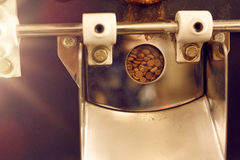 Window detail on a modern coffee bean roasting machine Royalty Free Stock Images