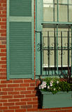 Window detail in old brick house. With flowers Royalty Free Stock Image