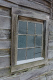 Window detail, winter, Cumberland Gap. Snow and frost cover the window of the old Gibbons cabin located in Hensley Settlement of the Cumberland Gap National park Stock Photo