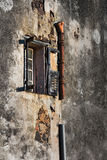 Window details : leakage. Detail of an abandoned house in Portinello, Corsica, France royalty free stock image