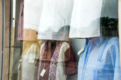 Window display of guayabera shirts Stock Images