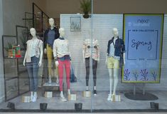 Window Display of the Next retail store in Bracknell, England. Bracknell, England - April 23, 2018: Window display of Spring fashion clothing for women in the Royalty Free Stock Photos