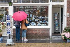 Window display of traditional Dutch handpainted pottery shop in royalty free stock image