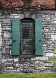 Window at Distillery. With green shutters against gray stone royalty free stock photos