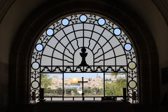 Window in Dominus Flevit Church. View of Jerusalem through the window in Dominus Flevit Church, at the Olive Mount, Israel Royalty Free Stock Image
