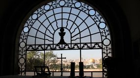 Window of Dominus Flevit Church, Jerusalem, Israel. Window of Dominus Flevit (The Lord has wept) Church with the view of Old Jerusalem, Mount of Olives Stock Photography