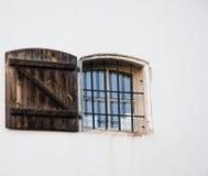 Window with door. Window with bars and door to shut Royalty Free Stock Photography