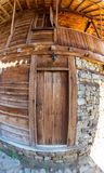 Window and door - an element of the stone-wooden architecture of the mountain village of Zheravna in Bulgaria. Mountain eco-village Zheravna - Bulgarian national royalty free stock images