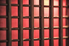 Window or door lattices, wooden with red light and carpet and the background. Window or door lattices, wooden with red light and carpet and the background Royalty Free Stock Images